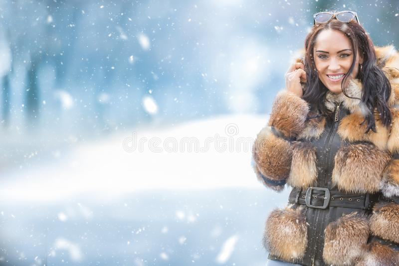 Winter portrait of attractive young woman in warm clothing from polar fox royalty free stock photography
