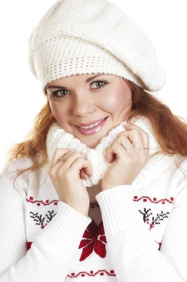Winter portrait the beautiful girl (Close up). The beautiful young woman in a white winter sweater stock image