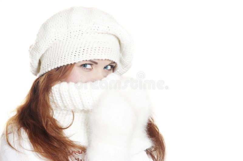 Winter portrait the beautiful girl (Close up). The beautiful young woman in a white winter sweater royalty free stock photos