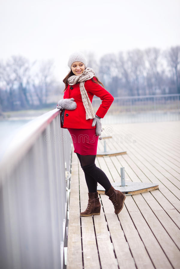 Winter portrait of beautiful pregnant woman royalty free stock image