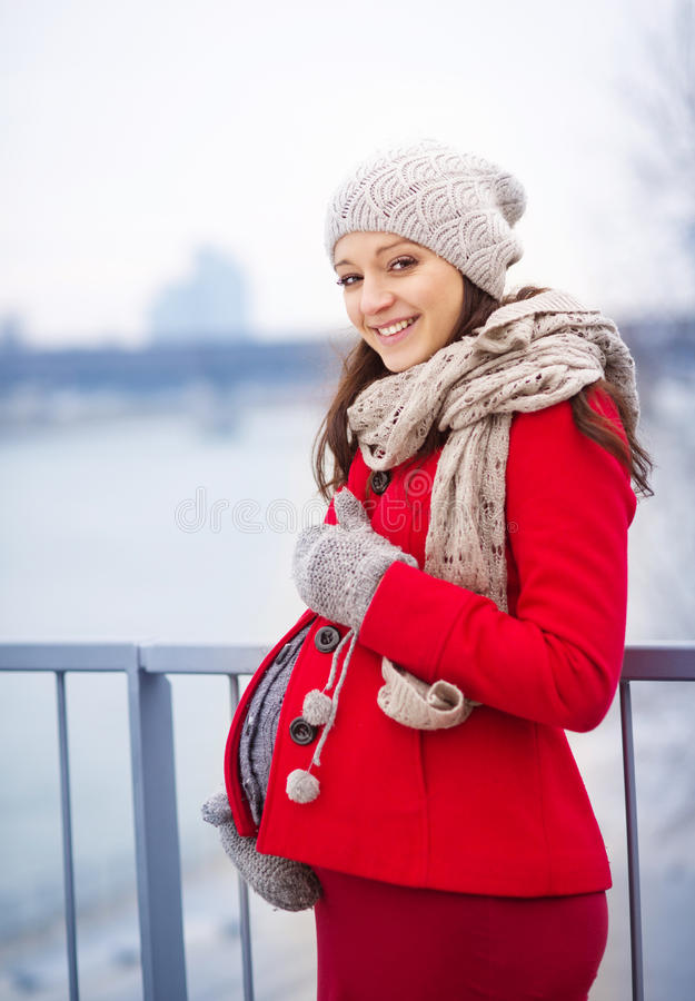 Winter portrait of beautiful pregnant woman royalty free stock photos