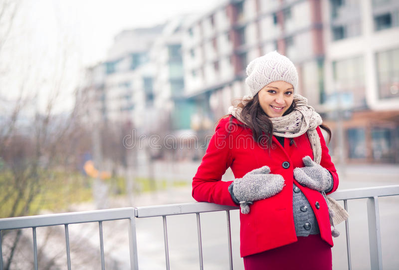 Winter portrait of beautiful pregnant woman stock photos