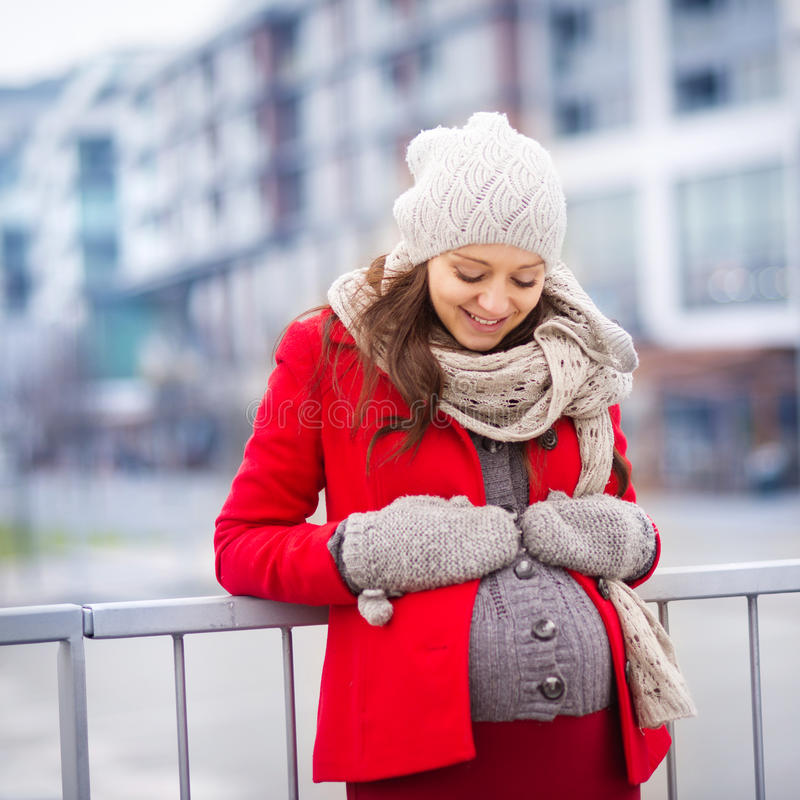 Winter portrait of beautiful pregnant woman royalty free stock photo