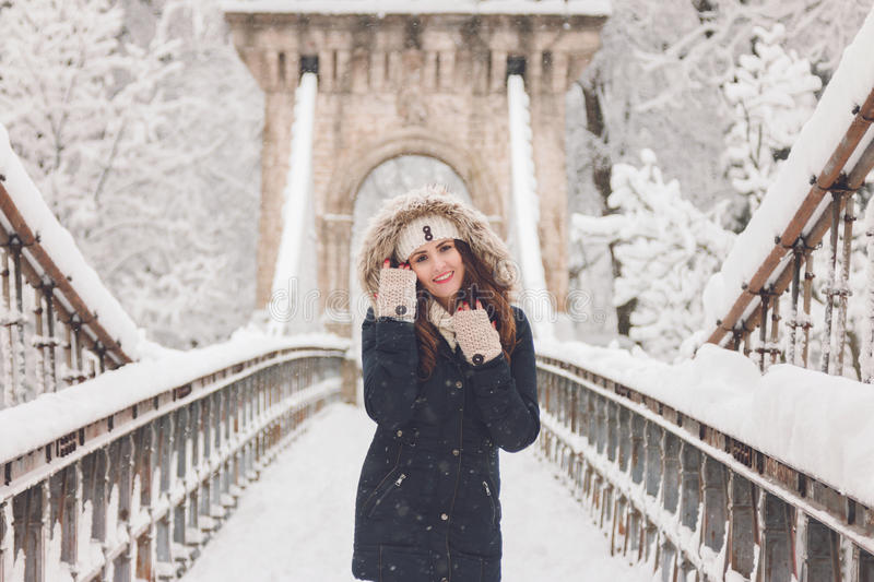 Download Winter Portrait Of A Beautiful Woman In The Snowfall Stock Photo - Image: 83709046