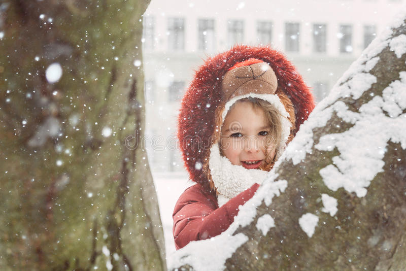 Winter portrait of child. Winter portrait of little child during snow,selective focus royalty free stock photos