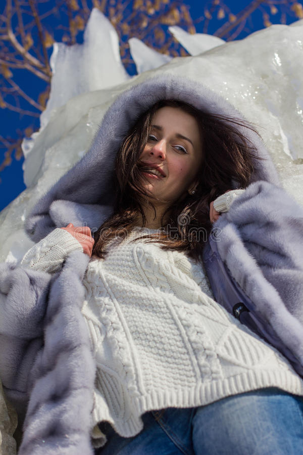 Winter portrait of a girl in a fur coat. Winter portrait of a girl stock photos