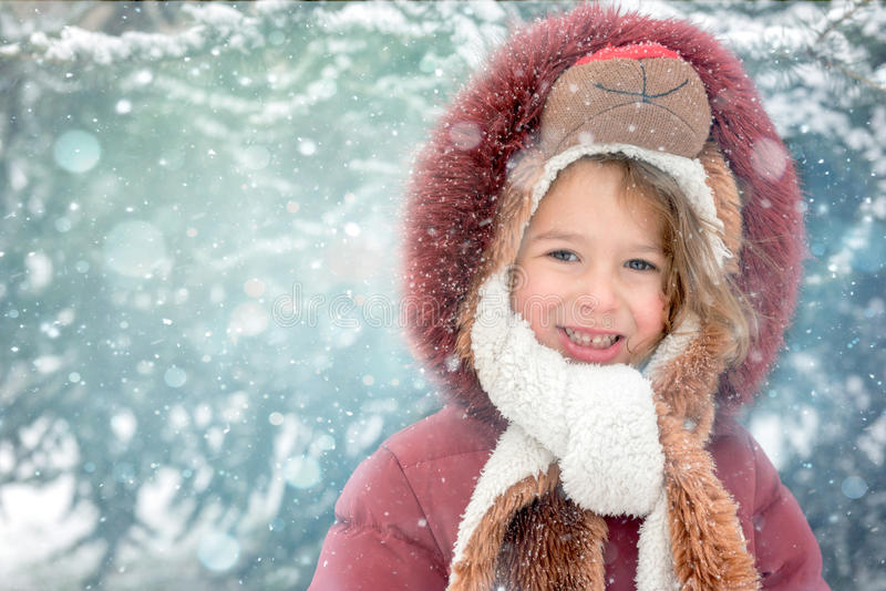 Winter portrait of the little girl. Winter portrait of little child during snow storm,selective focus royalty free stock images