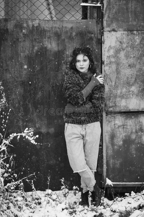 Winter portrait of a pretty girl without outerwear. Cold season. Winter portrait of a pretty girl without outerwear stock photo
