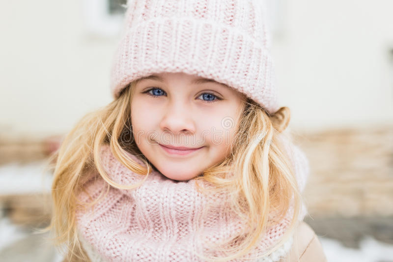 Winter portrait of smile child girl in hat and scarf stock photos