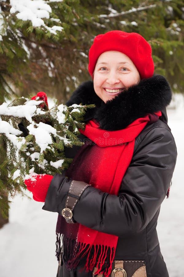 Winter portrait of woman. Outdoor winter portrait of mature woman near fir-tree stock photos