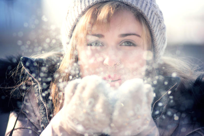 Winter portrait of a woman with snow in hands stock image