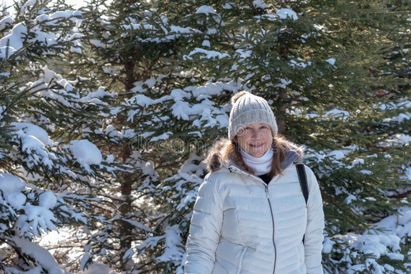 winter portrait of woman in snowy forest royalty free stock images