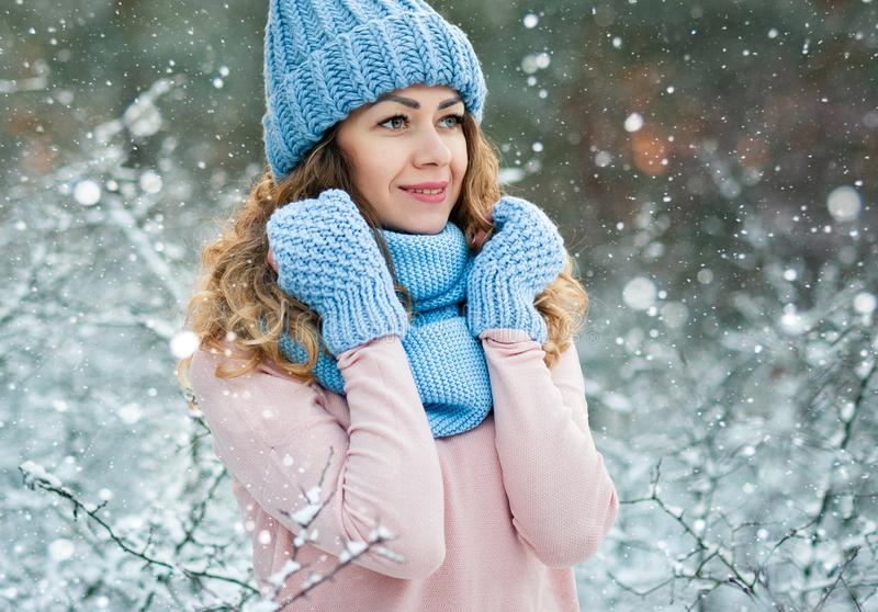 Beautiful smiling young woman in wintertime outdoor. Winter concept royalty free stock image