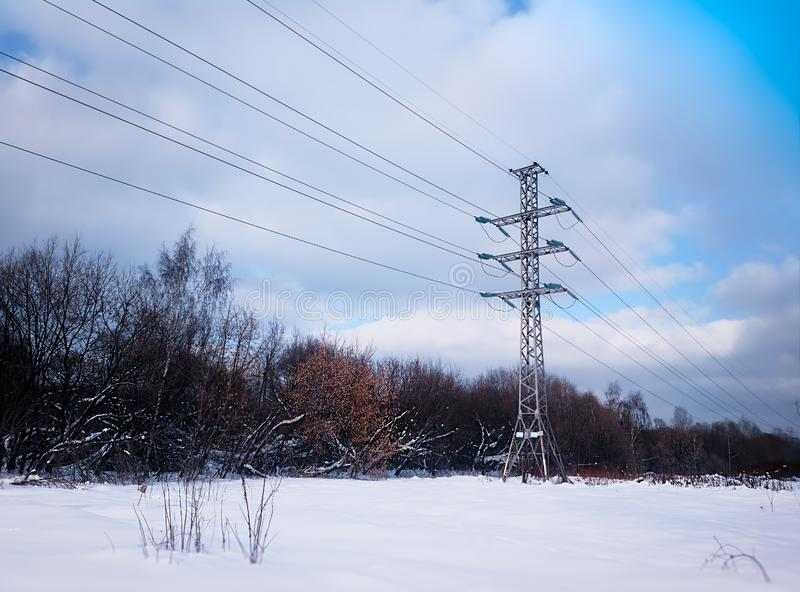 Winter power line in snow background stock photos
