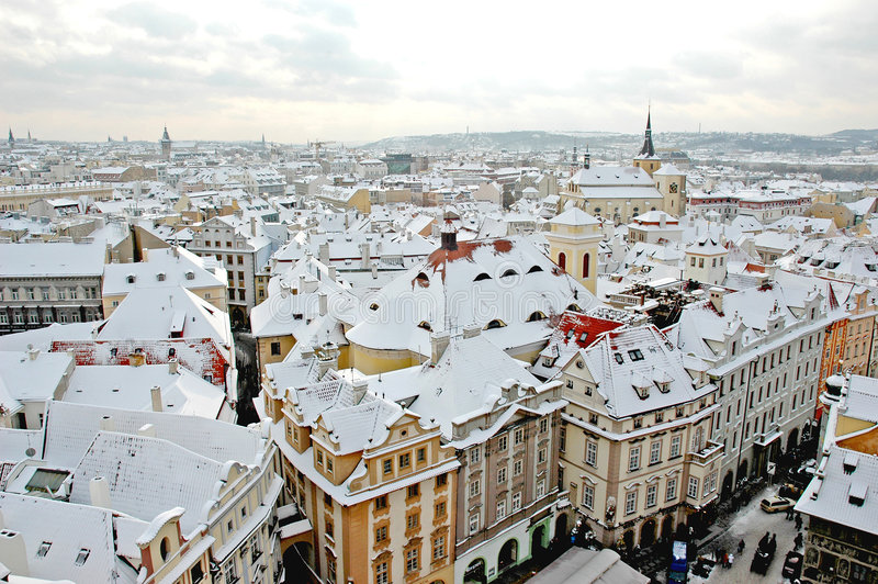 Winter Prague. View on snowy Prague rooftops royalty free stock photo