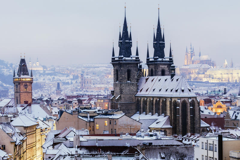 Winter in Prague - city panorama with Tyn Cathedral and Clock To. Wer. Prague, Bohemia, Czech Republic royalty free stock photo