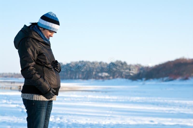 Winter pregnant woman portrait stock images