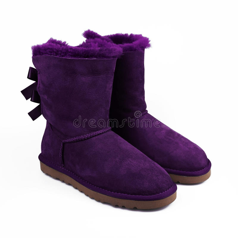 Winter purple shoes. Over white stock images
