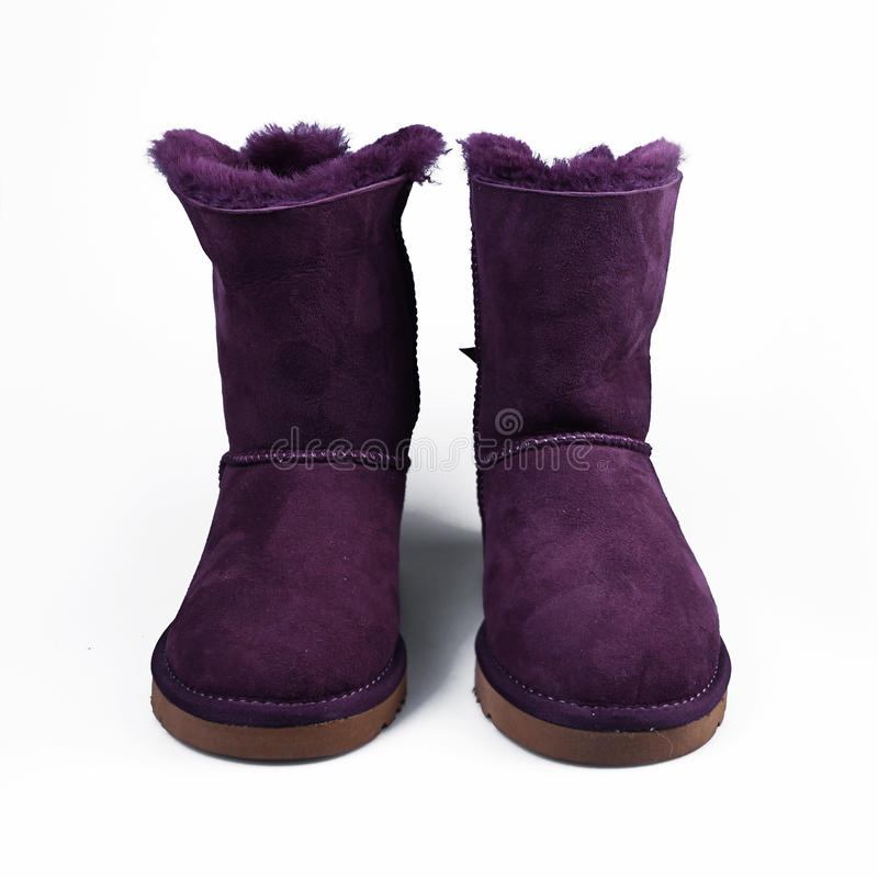 Winter purple shoes. Over white stock photos