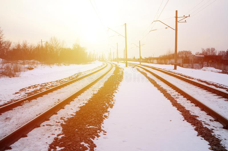Winter railway landscape. Industrial zone. The railroad between. The territories of the plants stock images