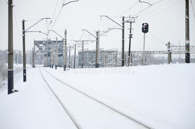 Winter railway landscape, Railway tracks in the snow-covered industrial country.  stock image