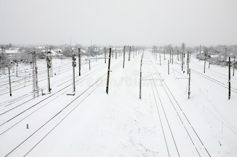 Winter railway landscape, Railway tracks in the snow-covered industrial country.  royalty free stock photos