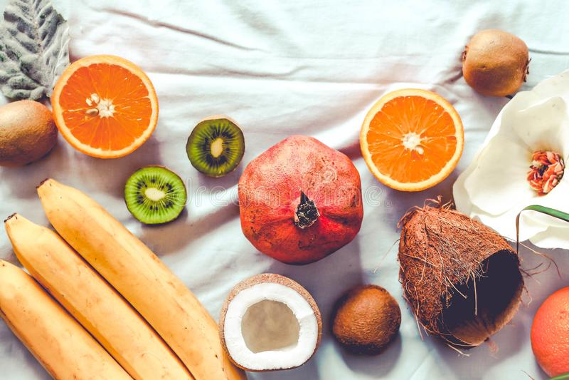 Winter raw fruits - coconut, kiwi, oranges royalty free stock photo