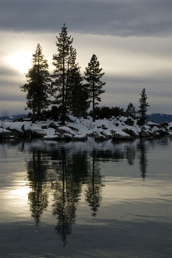 Winter Reflections in a Rocky bay stock image