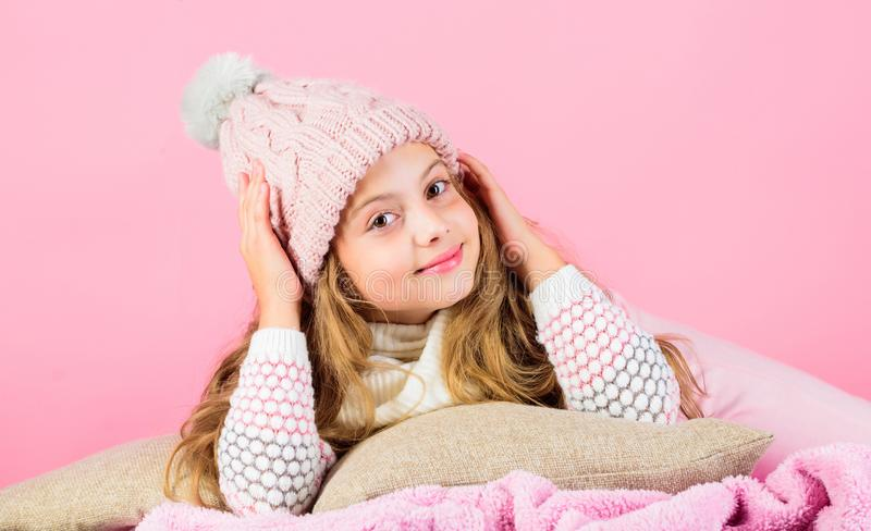 Winter rest and relax. Winter season concept. Winter fashion accessory. Kid girl knitted hat and scarf. Winter accessory. Concept. Girl long hair dream pink stock images