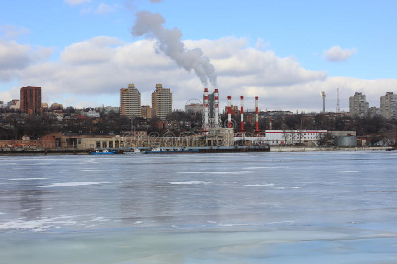 Winter river covered with ice on the background of the urban landscape stock photo