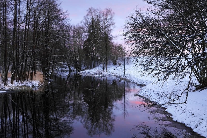 Winter river. Winter landscape with purple skies in the evening stock photography
