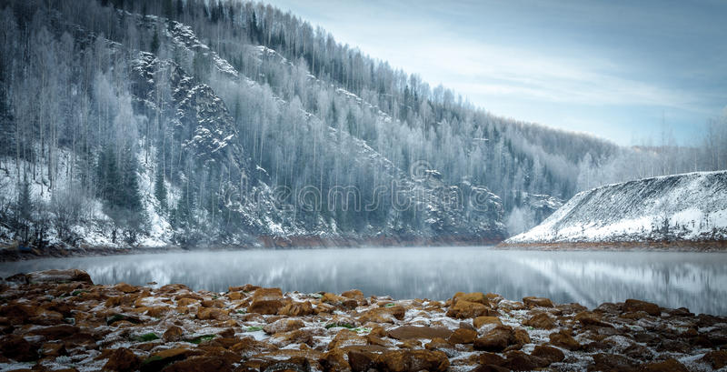 Winter riverside in the mountains stock photo