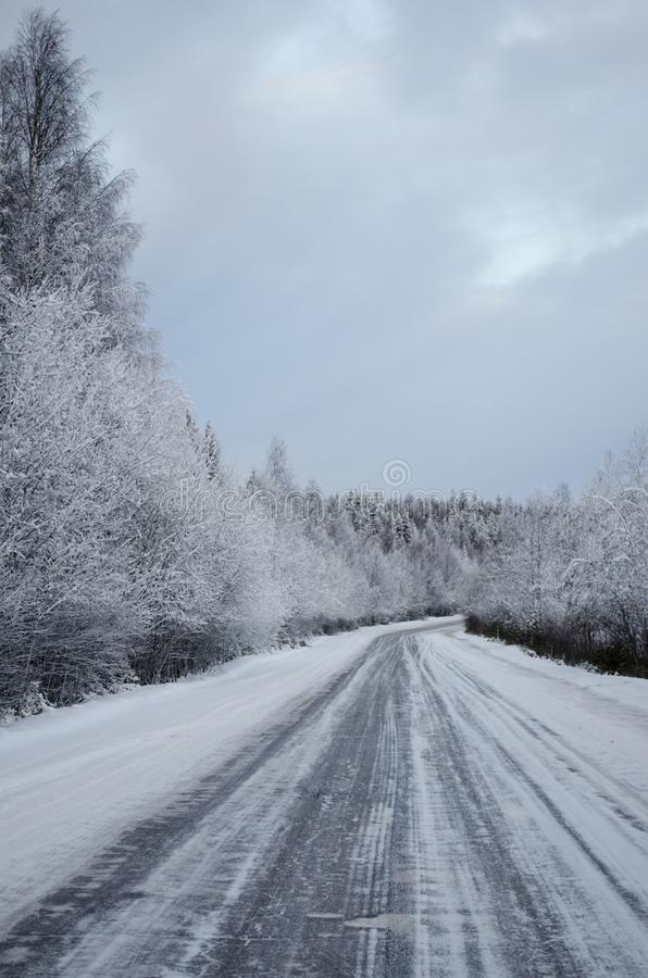 Winter road covered with snow. View of winter road covered with snow royalty free stock image