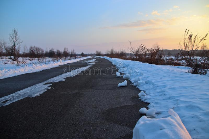 Winter road in February through the snow-covered steppe royalty free stock image