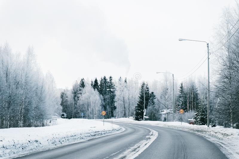 Winter road and a Snowy Forest in Cold Finland. Of Lapland royalty free stock photography
