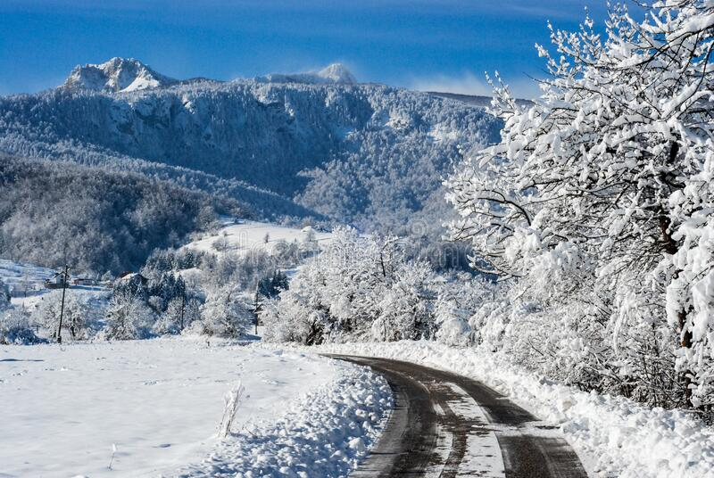 Winter road in snowy forest. Winter scene in mountains. Forest and hills covered with a snow. Snowy trees after heavy snowfall. Co. Ld winter day in nature stock photography