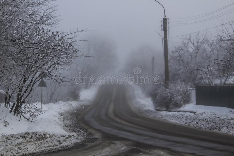 A Winter road to the fog. The way in the winter. Terrible fog. stock photography