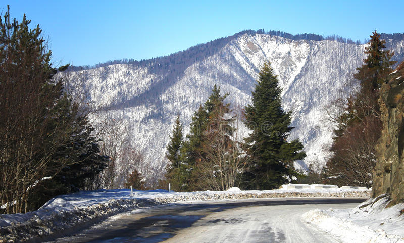 Winter road. To mountain, snow royalty free stock photography