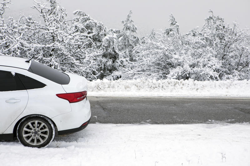 Winter Road. White car in snowy dangerous road royalty free stock photos
