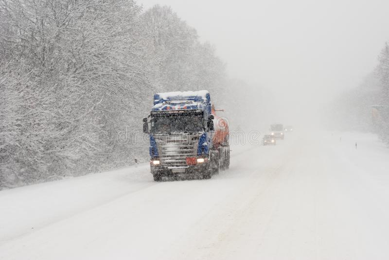 Winter roads, ice, drifts, heavy cargo transportation royalty free stock photography