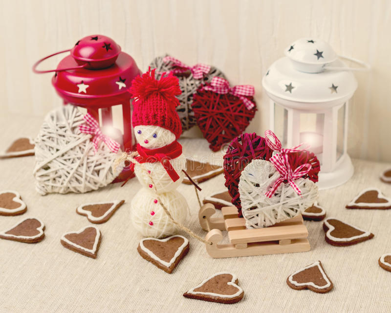 Winter romantic evening on Valentine's day. Valentine's day tabl. E setting with candles and decorations in the form of hearts stock photo