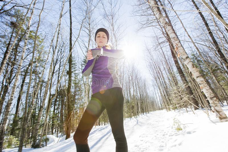 Winter running exercise. Runner jogging in snow. royalty free stock photo