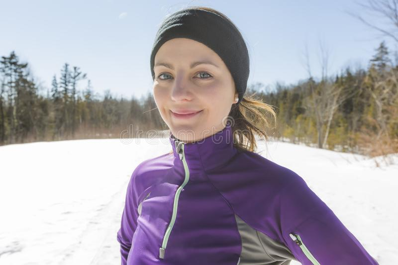 Winter running exercise. Runner jogging in snow. royalty free stock photography