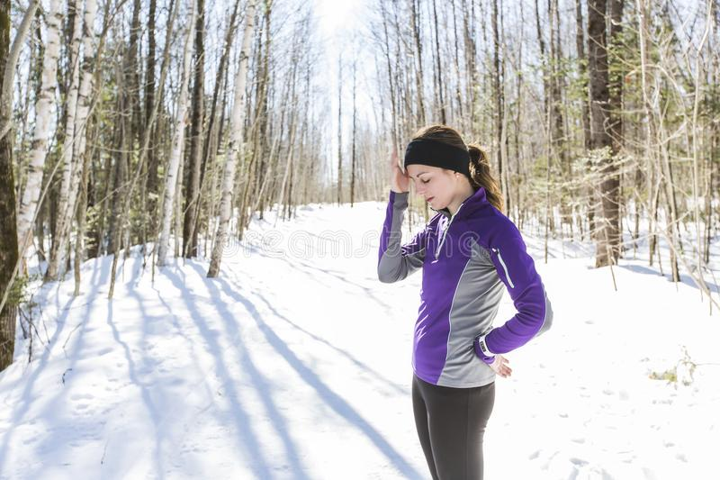 Winter running exercise. Runner jogging in snow. stock images