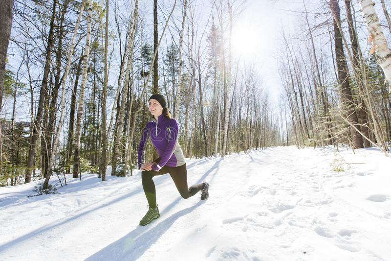 Winter running exercise. Runner jogging in snow. stock image