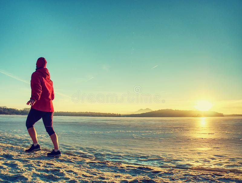 Winter running training. Middle age active person runner jogging royalty free stock photography