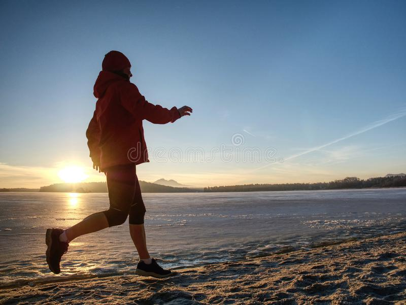Winter running training. Middle age active person runner jogging stock images