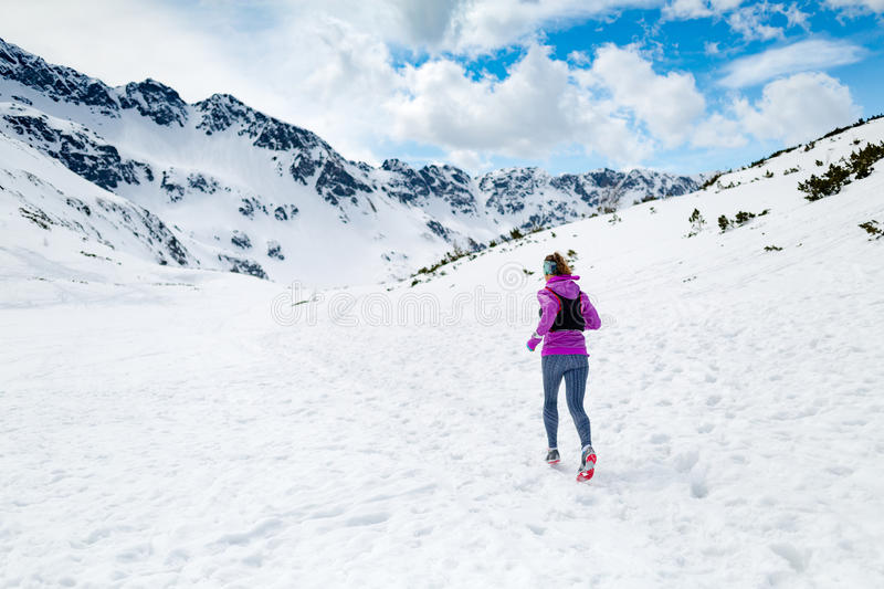 Winter running woman. Trail runner inspiration, sport and fitness stock photo