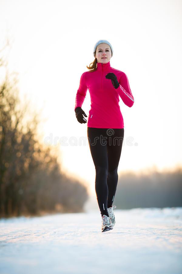 Free Winter Running - Young Woman Running Outdoors Royalty Free Stock Photos - 45662828