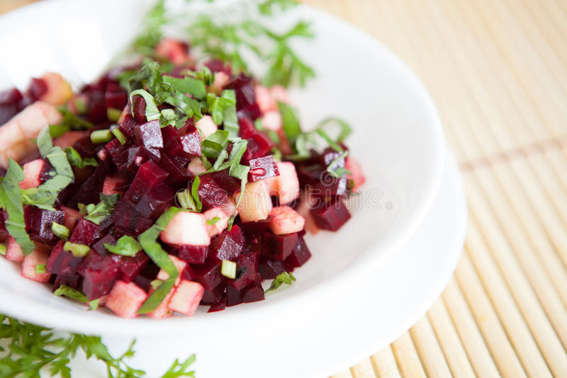 Winter salad of boiled beets and fresh apples stock photography